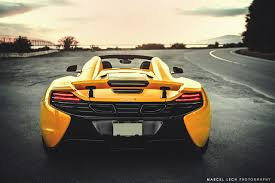 orange mclaren rear 2015 mclaren 650s spider in volcano yellow color rear photo