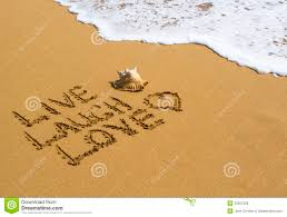 live laugh love message on the beach royalty free stock photos