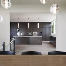 round pendant lighting in the dining room contrasted with the
