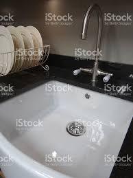 traditional kitchen blackgranite worktop counter white ceramic