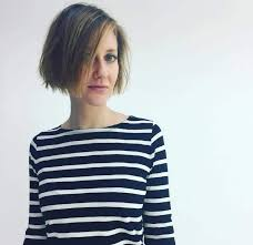 haircuts appropriate for navy women woman in a stripy navy and white breton top with short messy