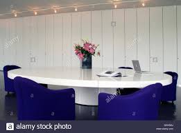 Large White Meeting Table Oval Conference Table With A Laptop And Chairs In A Modern Design