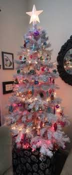 white christmas tree with multicolor lights redefining christmas persephone magazine
