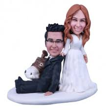 looking at these funny wedding cake toppers it must make you
