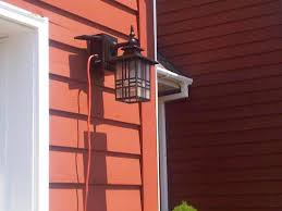 outdoor light fixture with built in outlet hton bay mission style black with bronze highlight outdoor wall