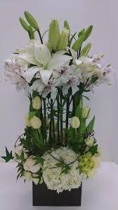 a fun flower arrangement of white lilies alstroemeria tulips