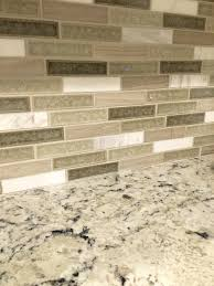 white delicatus granite with crystal cliff backsplash tile