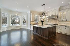 wood kitchen cabinets with white island white kitchen cabinets with wood island erigiestudio