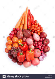 red color vegetables and fruits in water drop shape stock photo