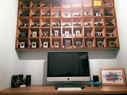 vintage on the shelf this photographer s office features his collection of vintage cameras
