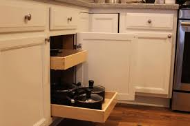 pull out drawers for kitchen cabinets orange juicer white framed