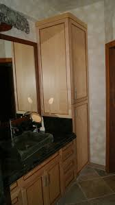 Bathroom Linen Closet Ideas Light Brown Wooden Linen Cabinets And Vanity With Black Top And