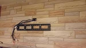 wall mount a tv over fireplace with no visible wires showing youtube