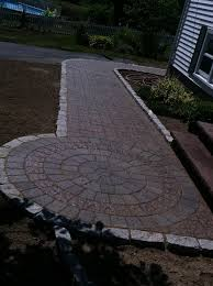 paver walkway w circle with cobble stone edging by araujo