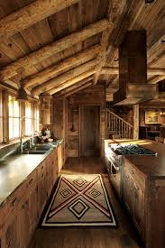 all i need is a little cabin in the woods 34 photos dark wood love the cabinets and soapstone or leathered granite countertops moose creek lodge miller architects counters with wood island
