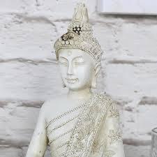 ornate sitting buddha ornament melody maison