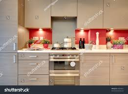 modern fitted kitchen modern fitted kitchen utensils ingredients placed stock photo
