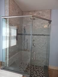 heavy glass panel and door cut pebble floor corian threshold