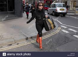 womens fashion boots uk with shopping bags wearing boots uk