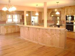 Alder Kitchen Cabinets by Knotty Alder Cabinets Featuring Arched Mesh Panel Doors And Live