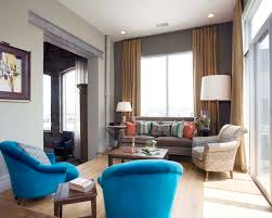 Single Living Room Chairs Design Ideas Blue Accent Chair In Living Room With Small Wooden Side Table