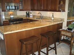 kitchen room brown cherry wood cabinets white stained wooden