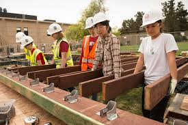 Construction Begins For Stanford S Student Designed Solar House House Floor Joists Construction