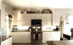 ideas for on top of kitchen cabinets top cabinet decorating ideas upandstunning club
