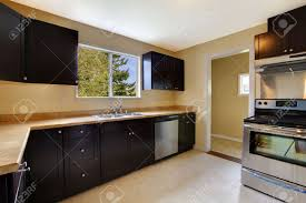 Black Brown Kitchen Cabinets by Kitchen Black Brown Cabinets And New Appliances Stock Photo