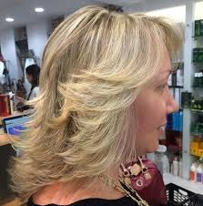 medium layered hairstyle for women over 60 the 25 best feathered hairstyles ideas on pinterest framed face