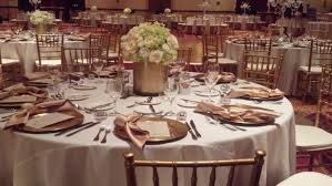 gold chiavari chairs gold chiavari chairs paired with gold chargers on white