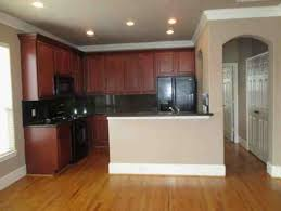 Mismatched Kitchen Cabinets Mismatched Wood And Cabinets In Open Kitchen Living Area Help