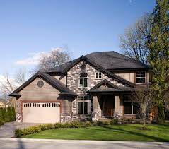 Two Story Home Large Two Story House With A Manicured Lawn A Combination Of Gray
