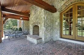 covered patio with fireplace patio fireplaces creating outdoor living room spaces