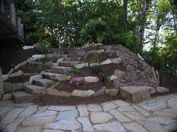 Rock Patio Designs Flagstone Patio With Rock Wall Mesmerizing Rock Patios Home