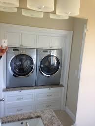 contemporary laundry room cabinets contemporary laundry room with raised washer dryer white cabinets