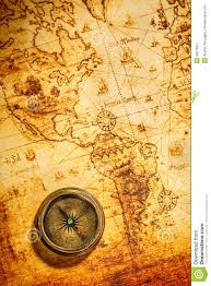 Ancient World Map by Vintage Compass Lies On An Ancient World Map Royalty Free Stock