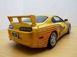 toyota supra fast and furious gold supra 2 fast 2 furious chicago criminal and civil defense