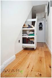 plentiful white wooden hidden storage under stairs with built in plentiful white wooden hidden storage under stairs with built in cabinetry shelves as space saving furnishings ideas