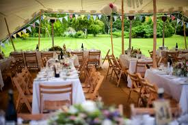 summer wedding inside one of our stretch tents looking out onto