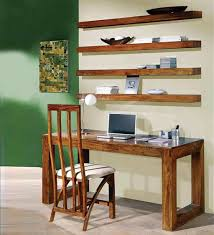 study room with wall mounted shelves and wooden table arrange
