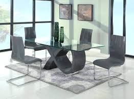 black glass extending dining table and chairs modern black glass