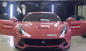 koenigsegg wrapped 15 year old wraps ferrari in supreme and louis vuitton