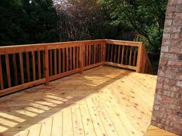 backyard garden with cedar decking different types of decking