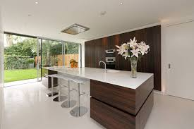 kitchens with dark cabinets 9 inspirational kitchens that combine dark wood cabinetry and white