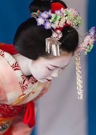 geisha or maiko practicing to be a professional geisha used to