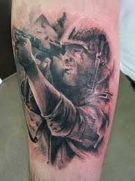 black adorable soldier tattoo on arm tattoomagz