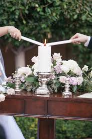 bride u0026 groom light unity candle during outdoor ceremony floral