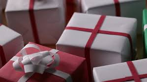 slow slide over lots of wrapped presents ready for delivery gift