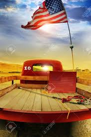 american flag truck concept photo of a vintage red vintage pick up truck with american